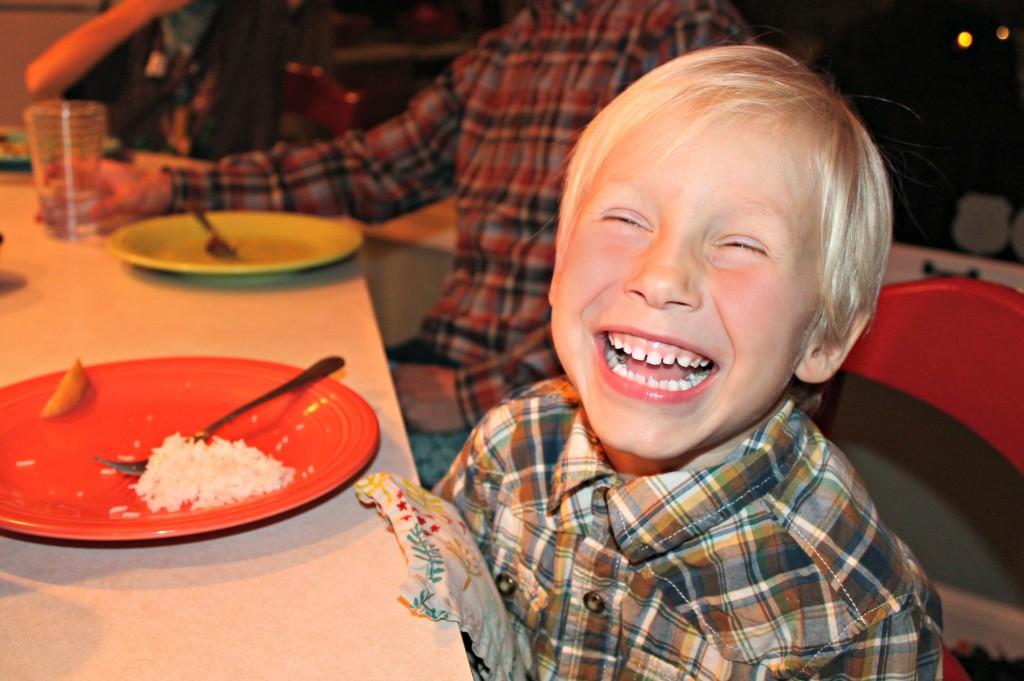 Happy dinner table boy