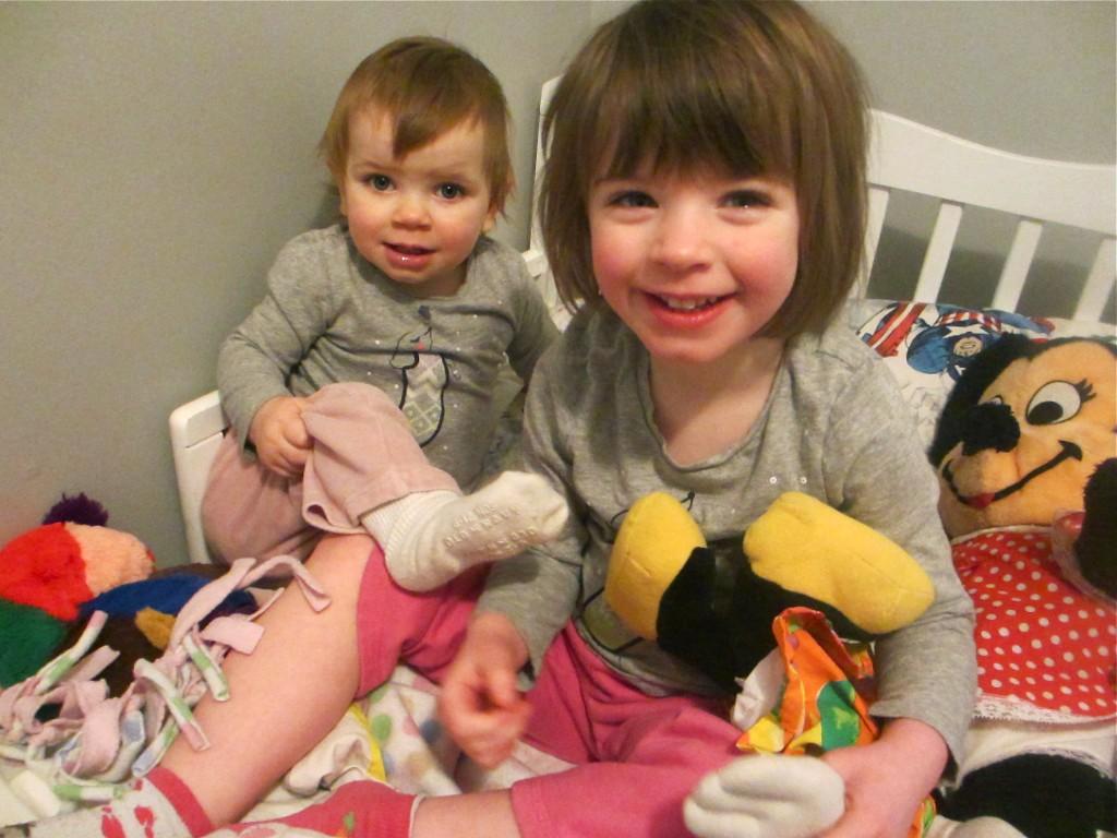 girls on toddler bed