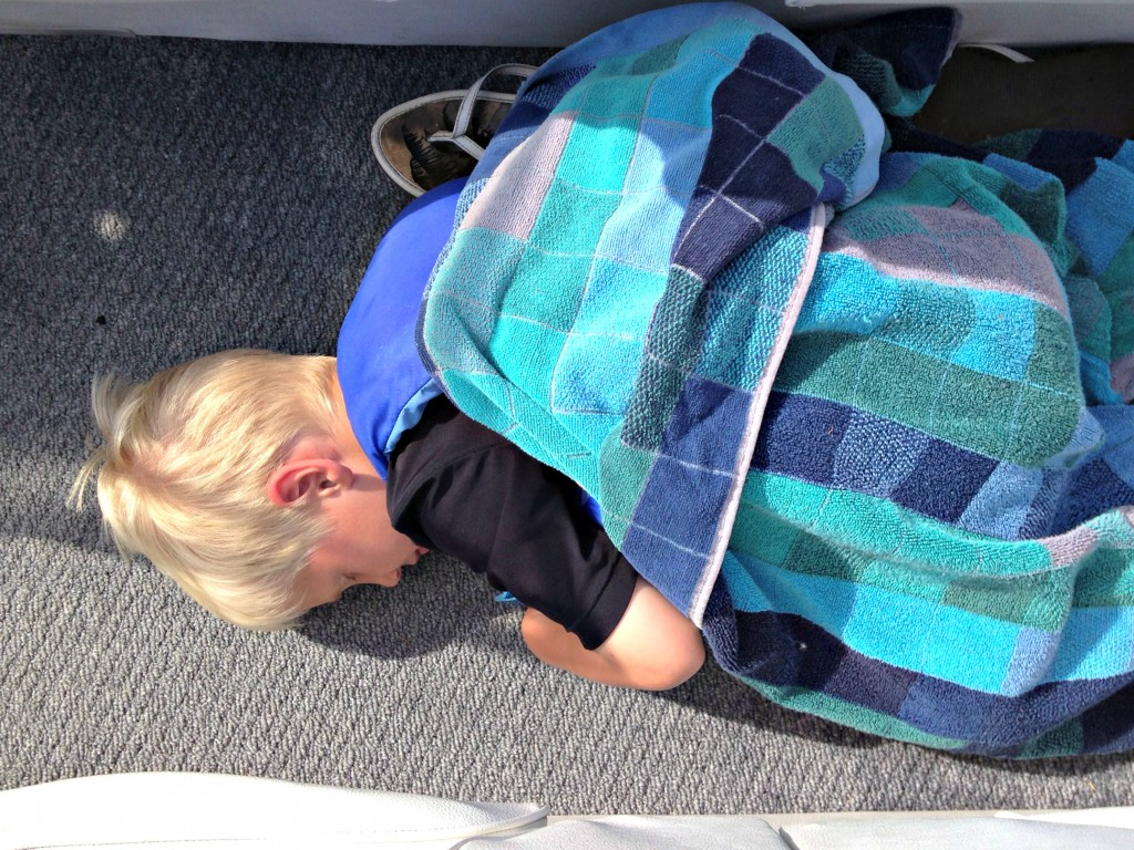 Noah asleep in boat